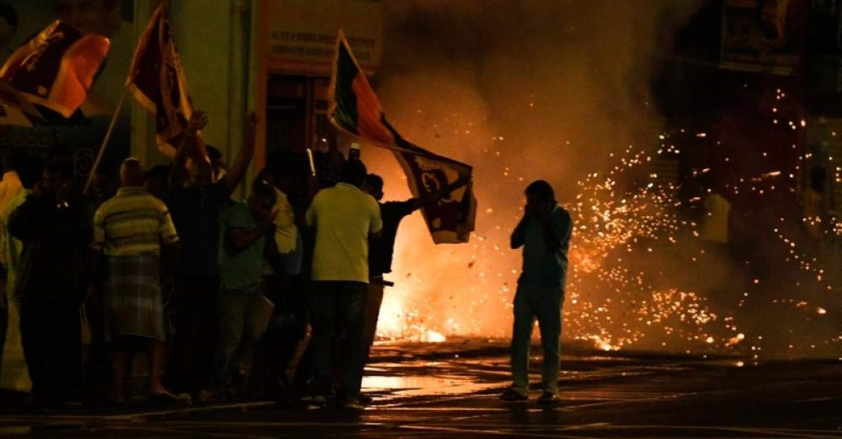 Supporters of presidential candidate Sajith Premadasa light up firecrackers to celebrate the closing of the voting at the end of the presidential election in Colombo on November 16, 2019. (AFP Photo)