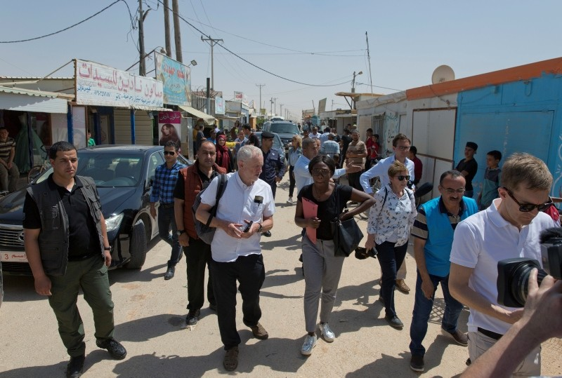 United Kingdom's Labour party leader Jeremy Corbyn inspects the main market road during his visit to the Zaatari Syrian Refugee Camp, in Mafraq, Jordan, Friday, June 22, 2018. (AP Photo)