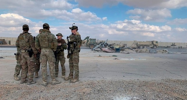 U.S. soldiers stand while bulldozers clear rubble and debris at Ain al-Asad air base in Anbar, Iraq, Monday, Jan. 13, 2020. AP File Photo