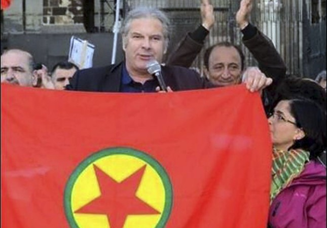 This file photo shows Andrej Hunko holding the banner of the PKK, which is listed as a terrorist group by Turkey and Germany.
