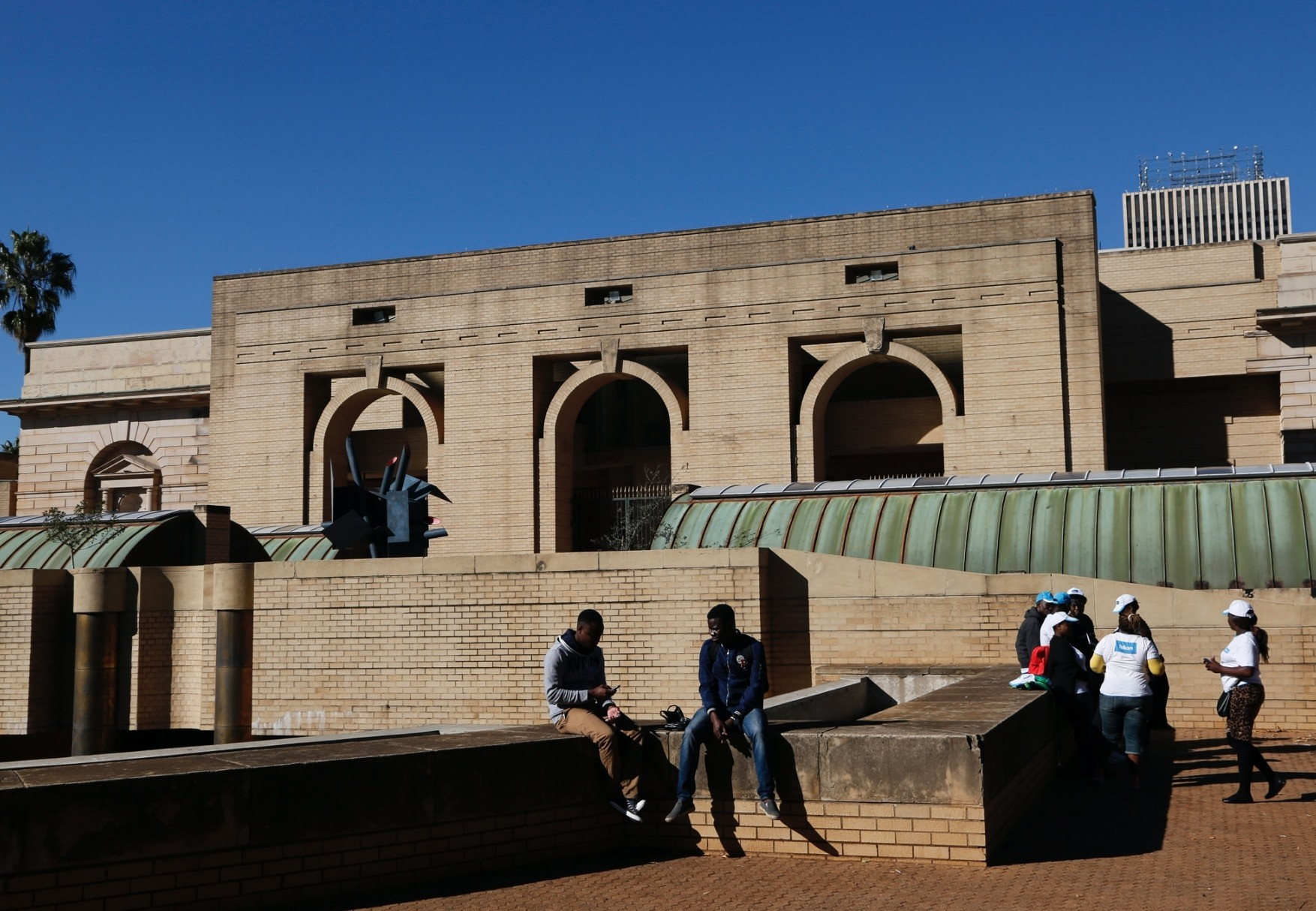 Photo shows people outside the closed main entrance to the Johannesburg Art Gallery, in Joubert Park.