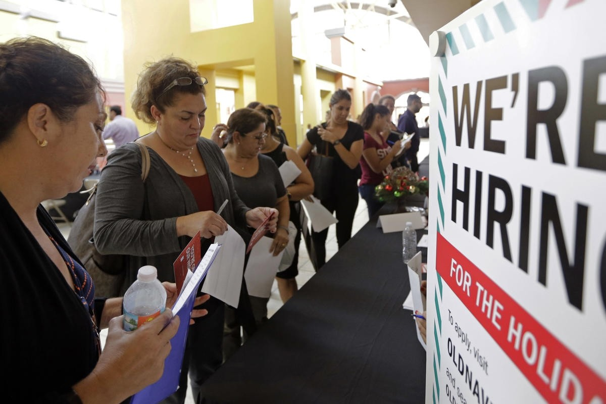 Job seekers wait in line to apply for part-time, full-time or seasonal positions at a job fair, Sweetwater, Florida.