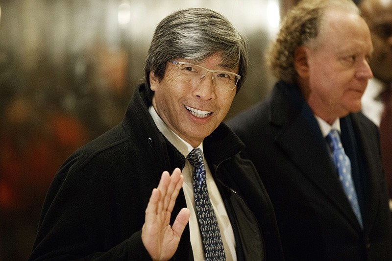 In this Jan. 10, 2017, file photo, pharmaceuticals billionaire Dr. Patrick Soon-Shiong waves as he arrives in the lobby of Trump Tower in New York for a meeting with President-elect Donald Trump. (AP Photo)
