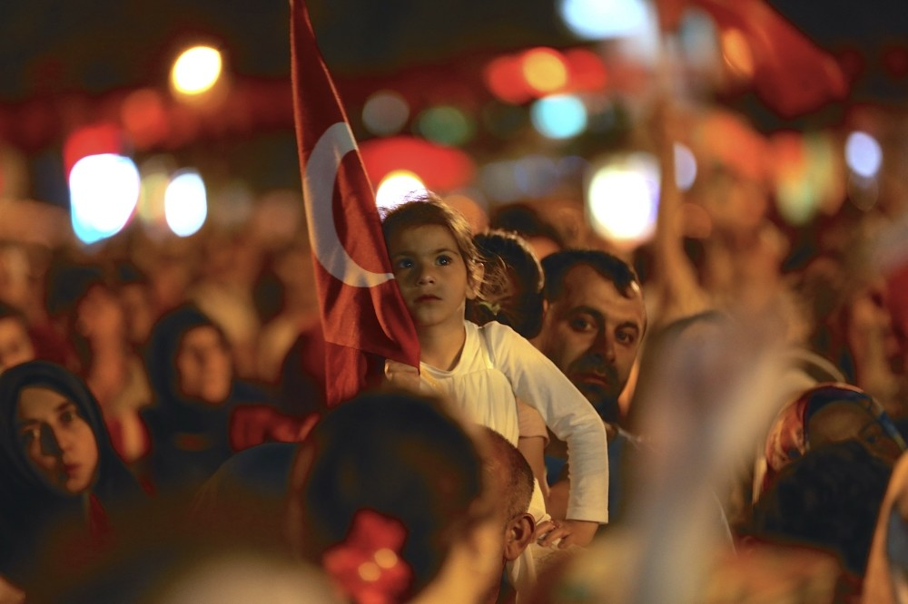 A child carrying a Turkish flag last year during the u201cDemocracy Watchesu201d that continued for weeks after the failed coup attempt.