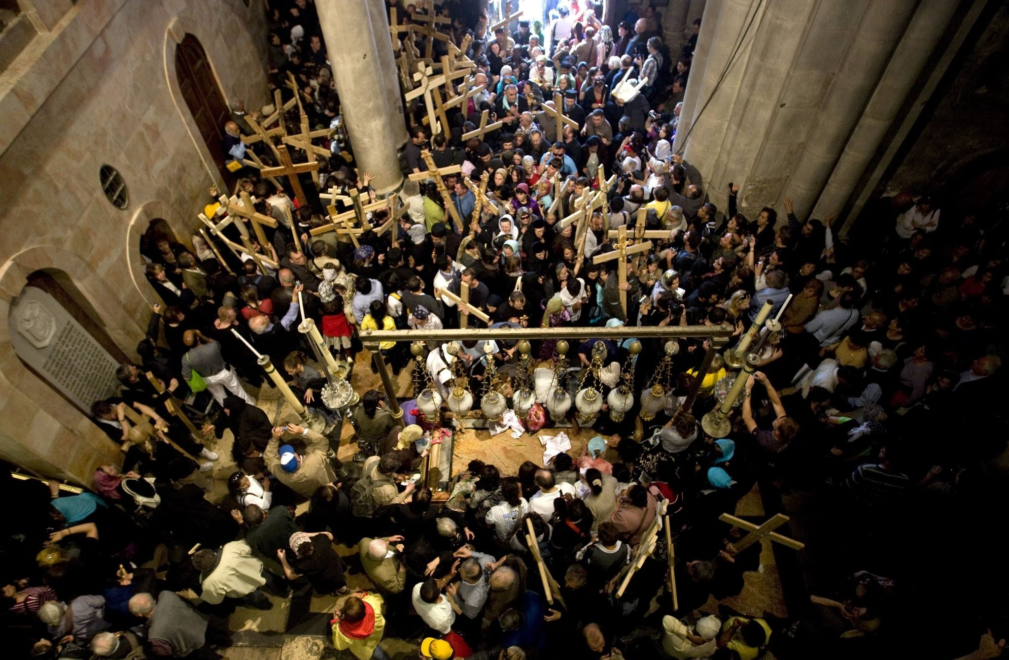 Christian worshipers walk the stone of atonement as they enter the Holy Sepluchre Church in Jerusalem's Old City during a Good Friday procession on April 2, 2010. (AFP Photo)