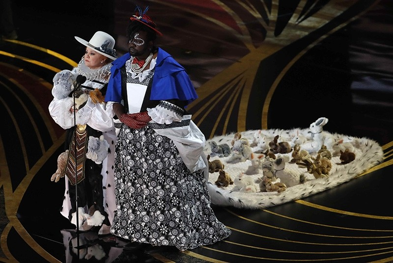 Melissa McCarthy and Brian Tyree Henry present the award for best costume design at the Oscars on Sunday, Feb. 24, 2019, at the Dolby Theatre in Los Angeles.