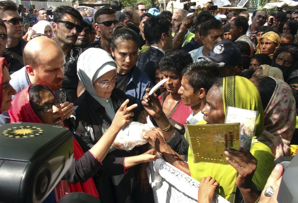 First lady Emine Erdou011fan, with her son Bilal Erdou011fan, interact with Rohingya Muslims at the Kutupalong refugee camp, Bangladesh, Sept. 7.