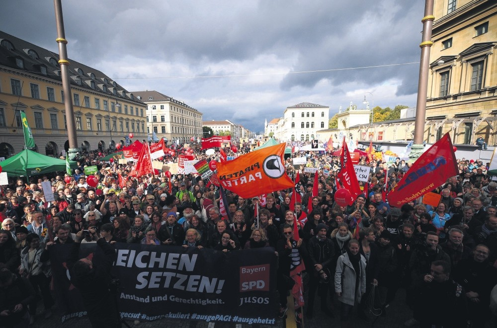People protest against the use of hate speech, growing populism across Europe and the increase in right-wing political parties during a rally in Munich, Germany, Oct. 3, 2018.
