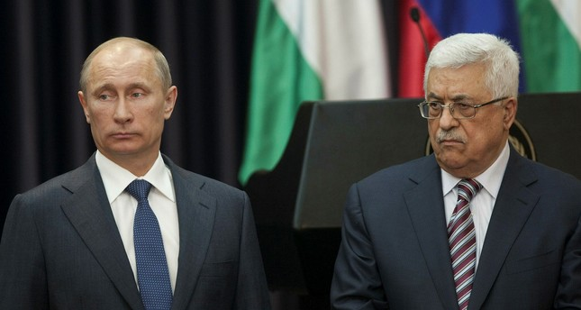 Russian President Vladimir Putin (L) and Palestinian leader Mahmoud Abbas (R) plan to discuss a possible new mediation mechanism to replace the Middle East Quartet.