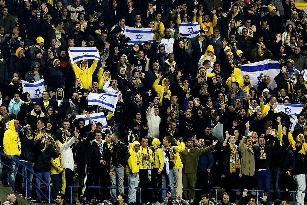 Supporters of Beitar Jerusalem cheer their team during a soccer match against Maccabi Umm el-Fahm at Teddy Stadium in Jerusalem in this January 29, 2013 file photo. (Reuters Photo)