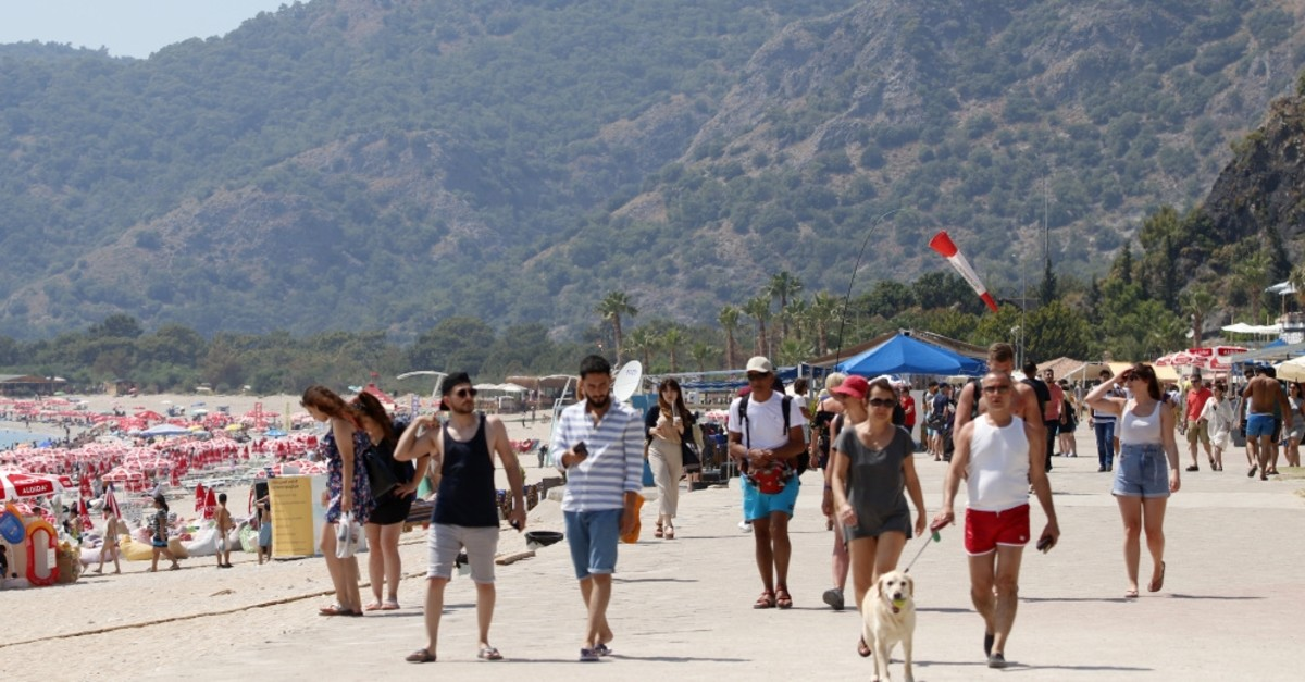 Holidaymakers on a beach in the seaside city of Fethiye in the Muu011fla province, June 5, 2019.