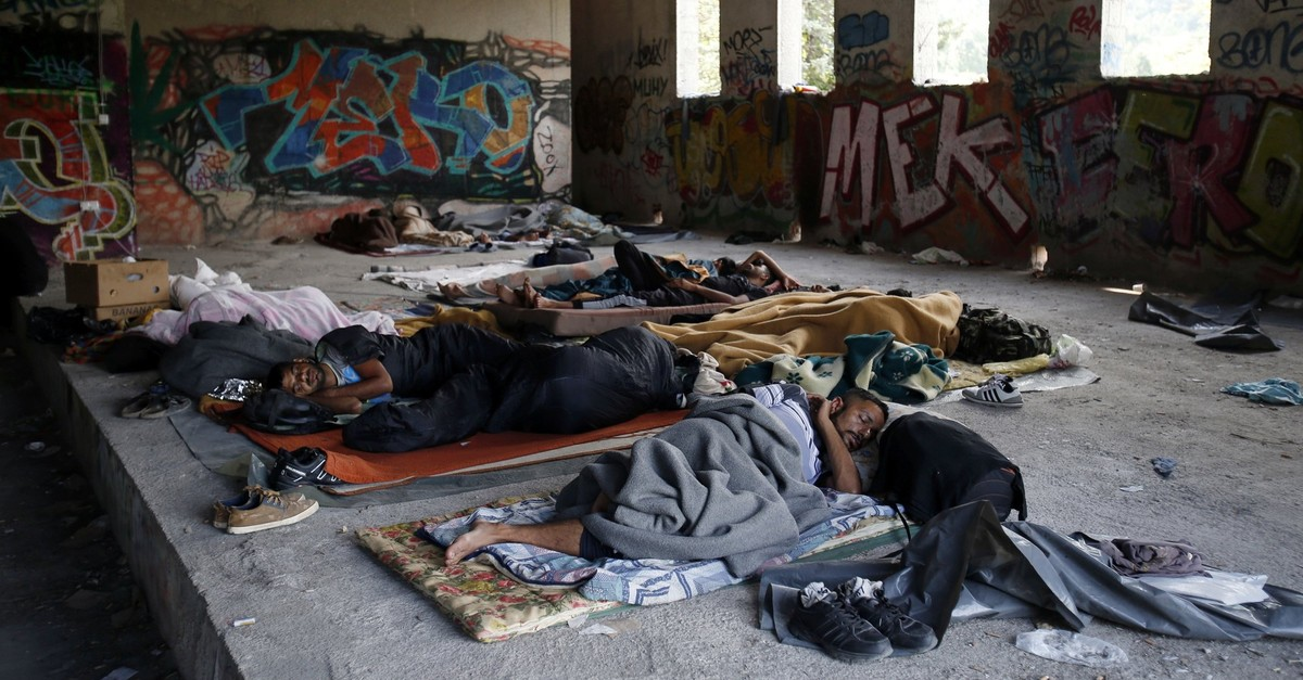 In this photo taken on Tuesday, Aug. 14, 2018, migrants sleep on the floor of a makeshift migrant camp in Bihac, 450 kms northwest of Sarajevo, Bosnia. (AP Photo)