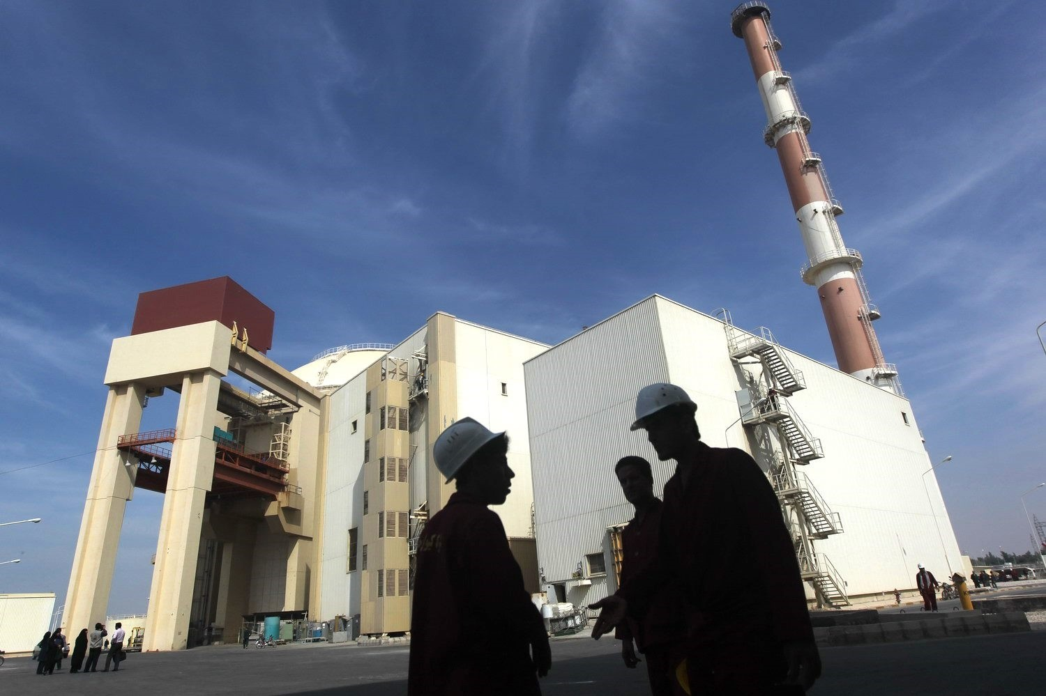 Workers in front of the reactor building at the Russian-built Bushehr nuclear power plant in southern Iran, 1,200 kilometers south of Tehran, Oct. 26, 2010.