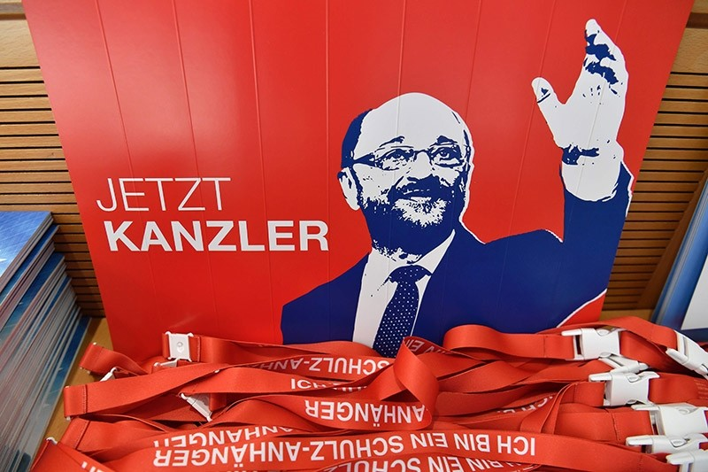 A placard featuring SPD chairman and candidate for chancellery Martin Schulz reading ,now chancellor, and campaigning material is displayed on August 1, 2017 at the Social Democrats Party headquarters in Berlin. (AFP Photo)