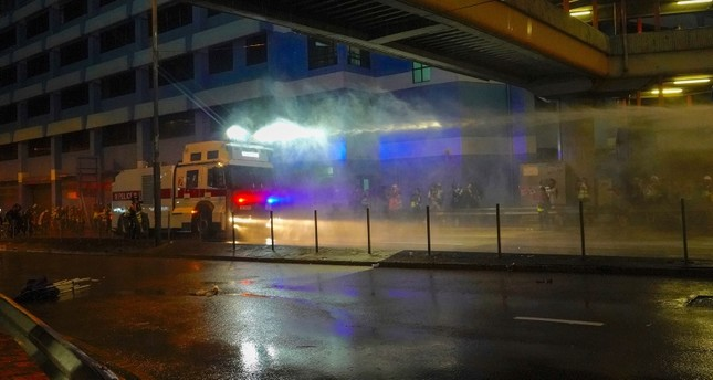 Police fire water cannon toward demonstrators during a protest in Hong Kong, Sunday, Aug. 25, 2019. (AP Photo)