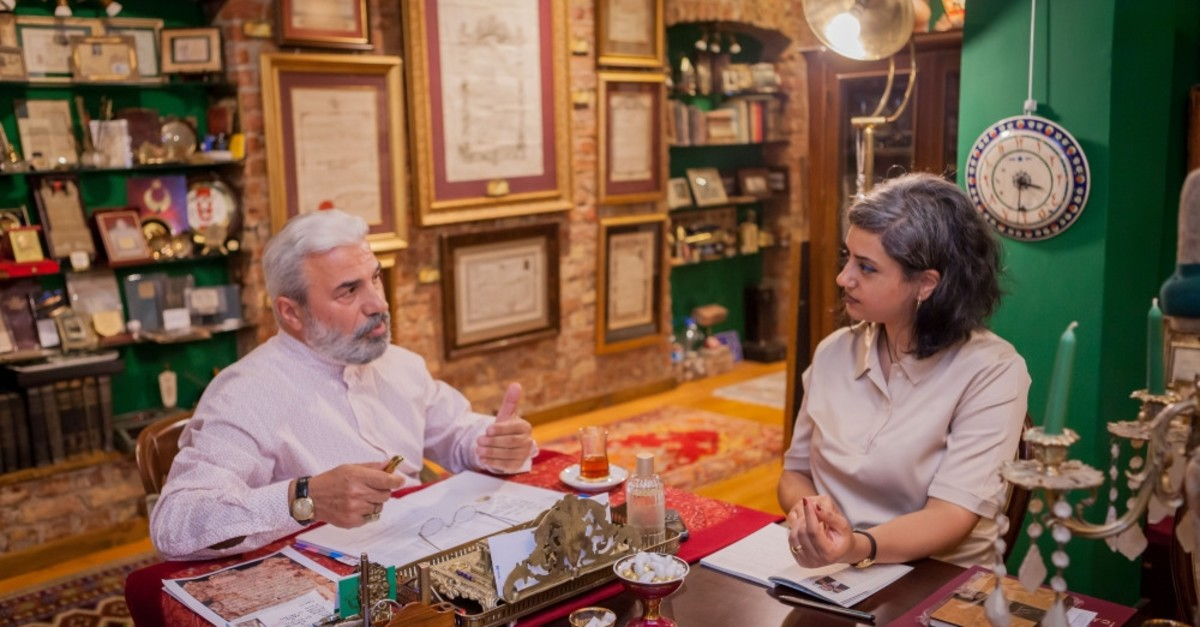 Daily Sabah Culture and Arts editor Zeynep Esra u0130stanbullu and collector Enver Beu015finci having a conversation on the history of ijazah licences.