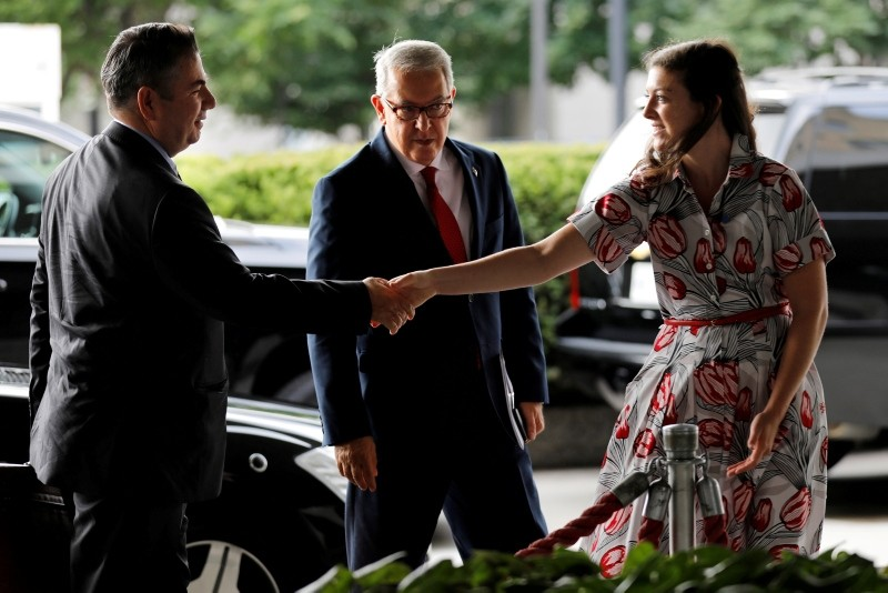 Deputy Foreign Minister Sedat u00d6nal (L) is greeted by a U.S. State Department protocol official as ambassador to the U.S. Serdar Ku0131lu0131u00e7 looks on upon their arrival at State Department in Washington, U.S., August 8, 2018. (Reuters Photo)
