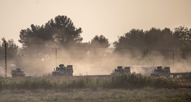 Turkish army vehicles drive toward the Syrian border near Akçakale in southeastern Şanlıurfa province, Oct. 9, 2019. (AFP Photo)