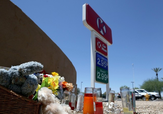 A makeshift memorial for Elijah Al-Amin is set up at a local Circle K store for the death of the stabbing victim Tuesday, July 9, 2019, in Peoria, Ariz.(AP Photo)