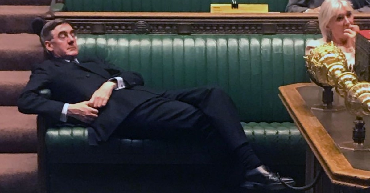 Britain's Leader of the House of Commons Jacob Rees-Mogg relaxes on the front benches in the House of Commons, London, Sept. 3, 2019.