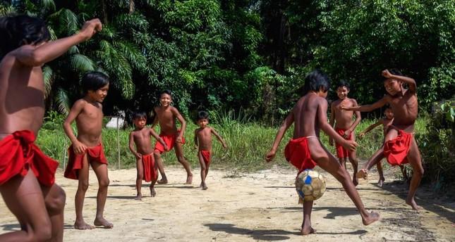 Waiapi boys play football in the Manilha village.