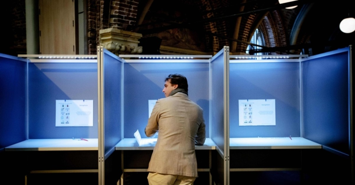 Eurosceptic Forum for Democracy (FvD) party leader Thierry Baudet stands at a polling booth as he votes in the Netherlands' provincial and water authorities elections at a polling station in Amsterdam, March 20, 2019. (AFP Photo)