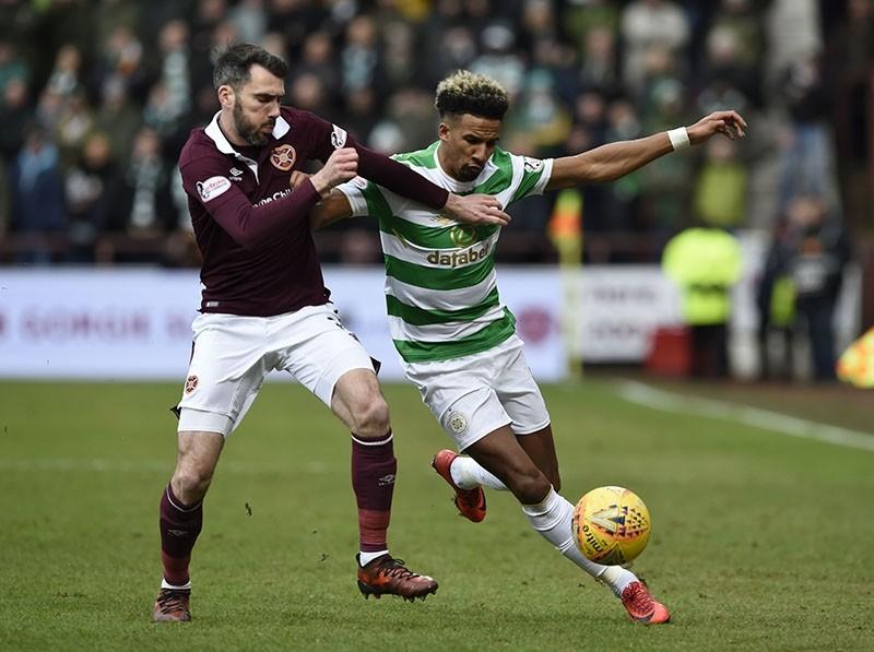 Hearts Michael Smith tackles Celtic's Scott Sinclair during their Scottish Premiership soccer match at Tynecastle Stadium in Edinburgh, Scotland, Sunday Dec. 17, 2017. (AP Photo)