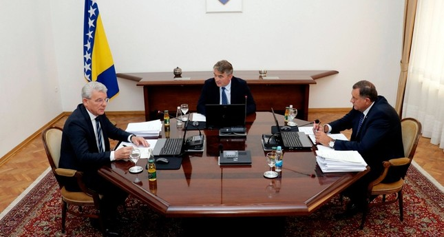 Members of Bosnia's tripartite presidency, Muslim member Sefik Dzaferovic, left, Croat member Zeljko Komsic and Bosnian Serb member Milorad Dodik, right, speak during a meeting in Sarajevo, Bosnia, Tuesday, Aug. 20, 2019. (AP Photo)