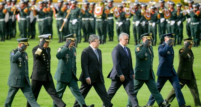 Colombian President Ivan Duque (C-R) and Colombian former Foreign Minsiter Carlos Holmes Trujillo (C-L) attend a ceremony, Bogota, Nov. 16, 2019. (AFP Photo)