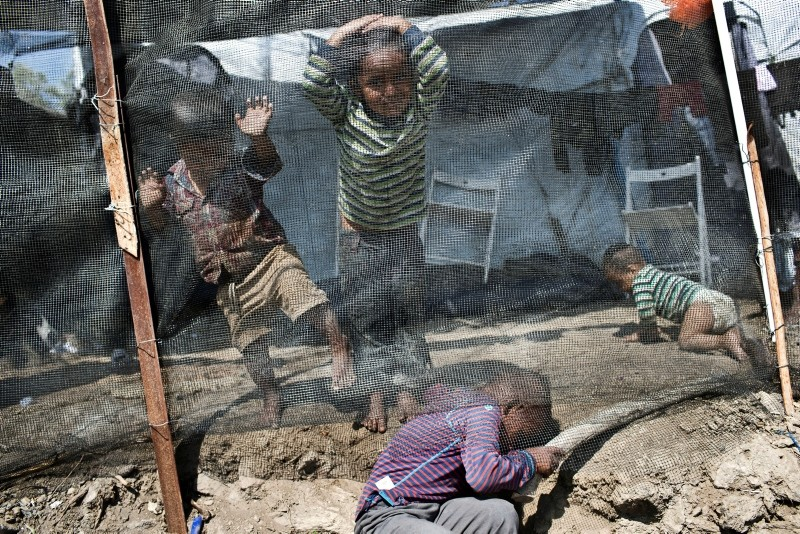 In this Wednesday, May, 2, 2018, file photo, children play inside the Moria refugee camp on the northeastern Aegean island of Lesbos, Greece. (AP Photo)