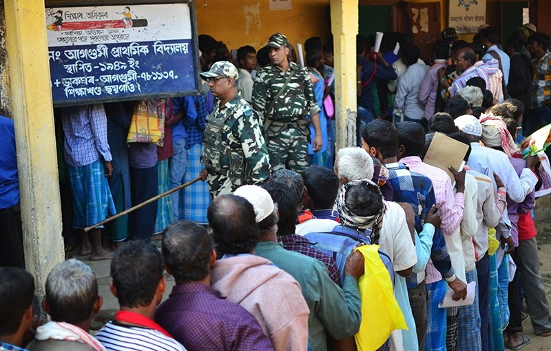 People stand in line to check their names on the first draft of the National Register of Citizens (NRC) at Gumi village of Kamrup district in the Indian state of Assam on January 1, 2018. (AFP Photo)