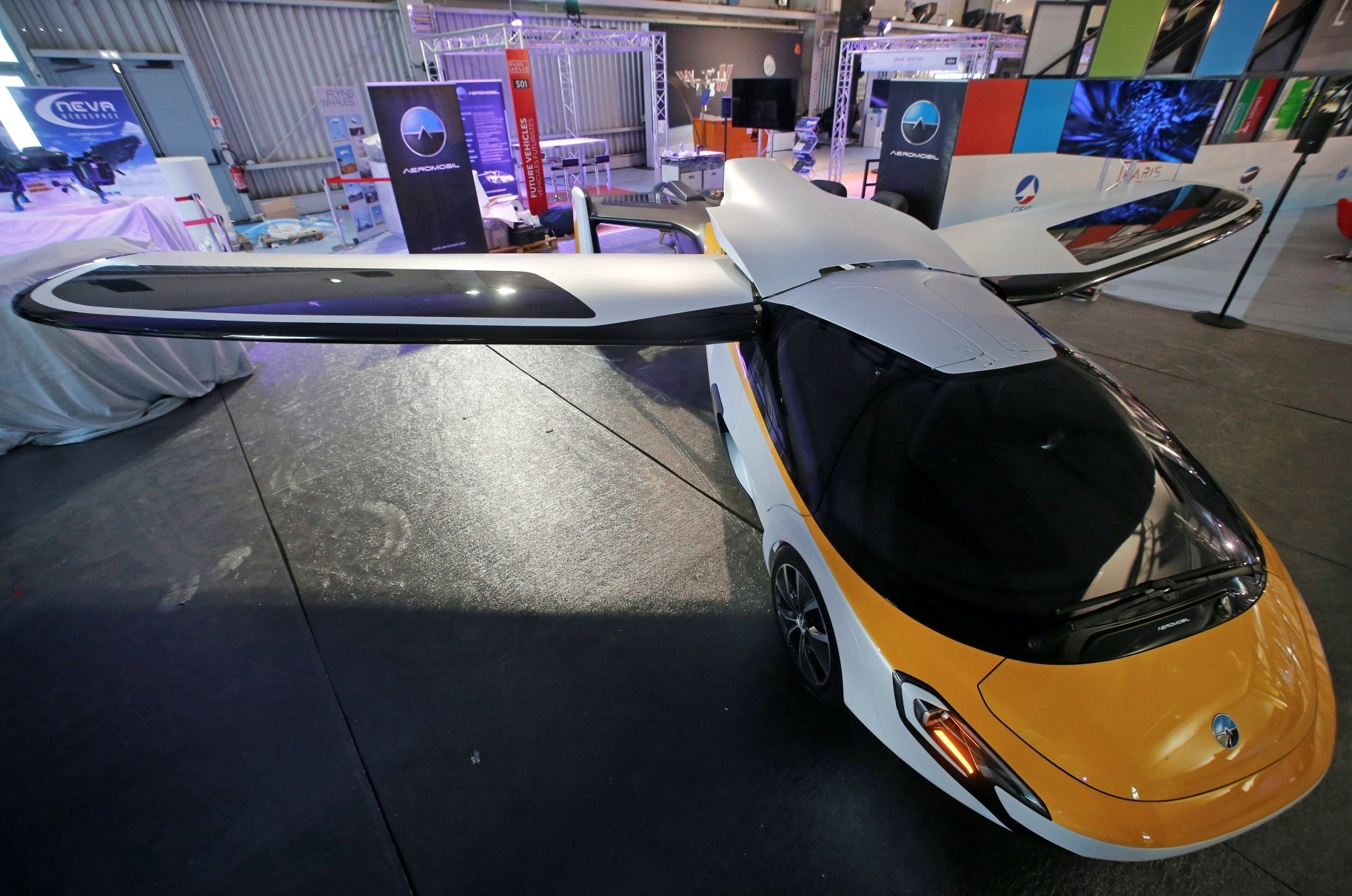 A flying car developed by AeroMobil, able to fly at a height of 3048 meters and a distance of 700 kilometers is seen on static display, before the opening of the 52nd Paris Air Show at Le Bourget Airport near Paris.