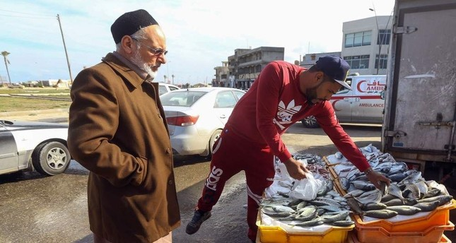 A man buys fresh fish from a stall in the Libyan capital Tripoli, Jan.13, 2020. AFP PHOTO