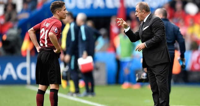 Turkey coach Fatih Terim, right, talks to 18-year-old player Emre Mor during the Euro 2016 Group D soccer match between Turkey and Croatia at the Parc des Princes stadium in Paris, France, Sunday, June 12, 2016. AP Photo