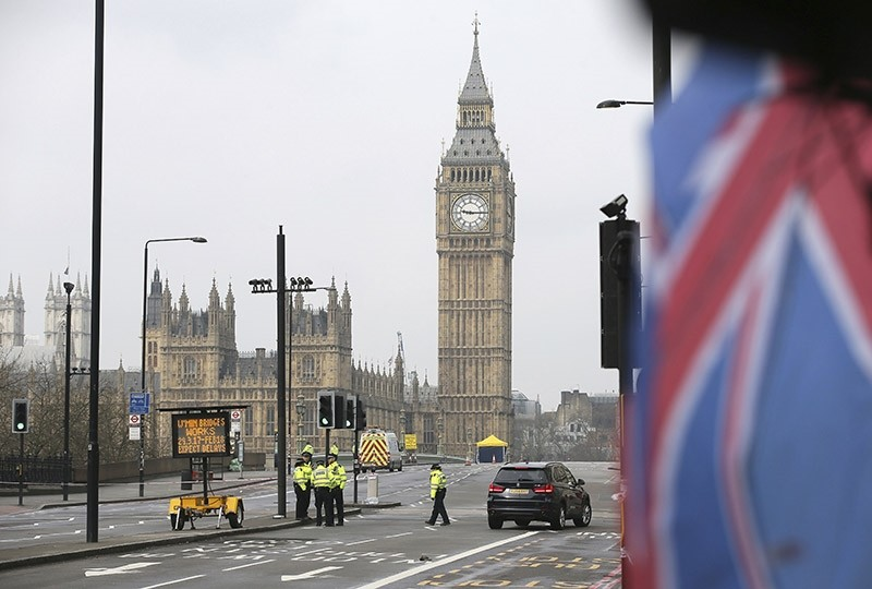 Police work at Westminster Bridge with the Houses of Parliament in background, in London, Thursday March 23, 2017. (AP Photo)