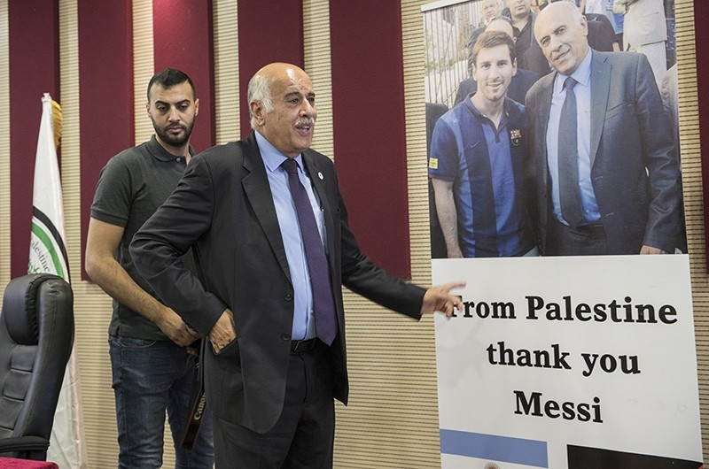 Palestinian chief of Football Associations Jibril Rajoub, stands next to his picture with Argentinian soccer player Lionel Messi, during a press conference in the West Bank town of Ramallah, June 7, 2018. (EPA Photo)