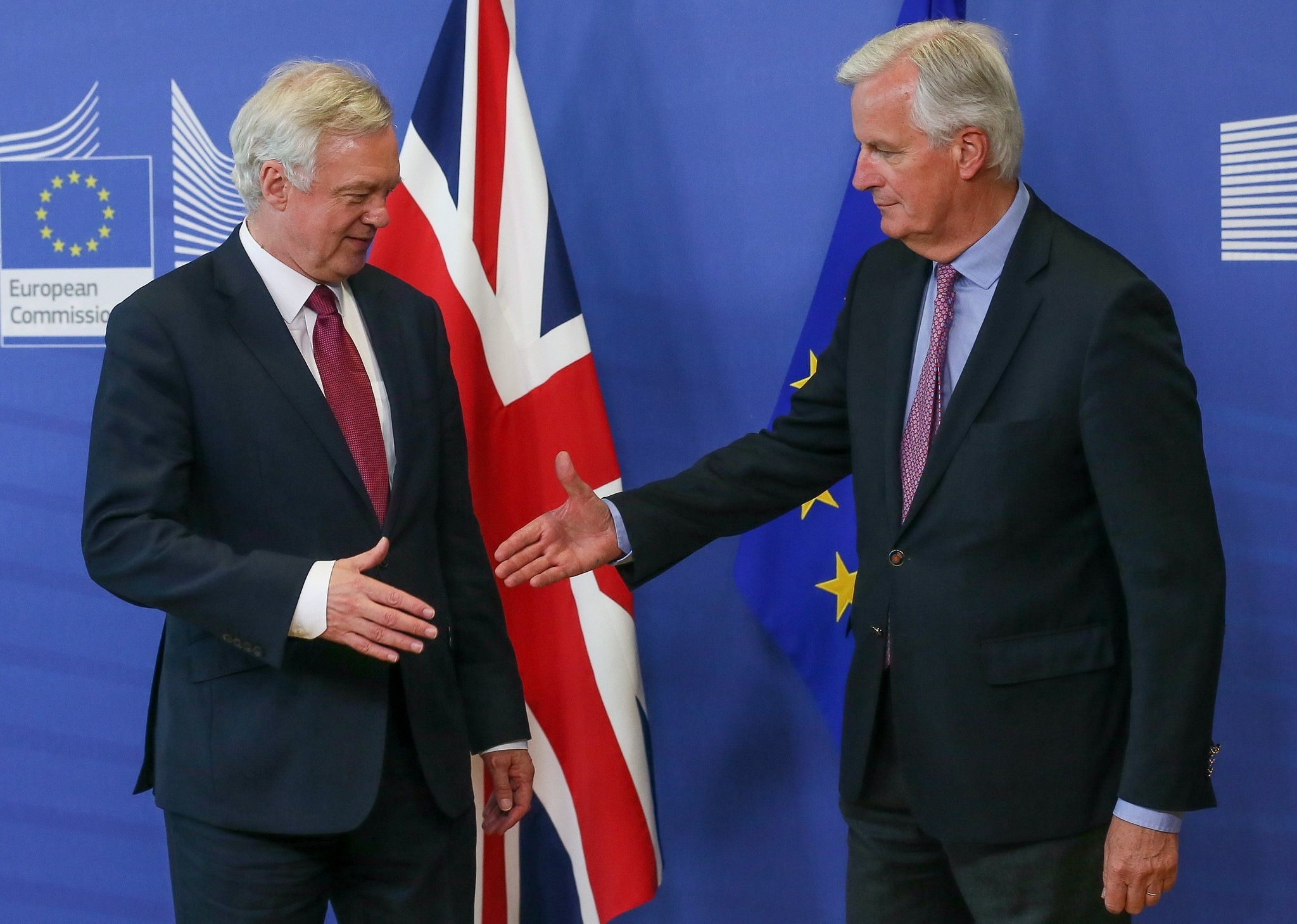 UK Secretary of State for Exiting the EU, David Davis (L) is  welcome by Michel Barnier, the European Chief Negotiator of the Task Force for the Preparation Conduct of the Negotiations with the UK under Article 50. (EPA Photo)