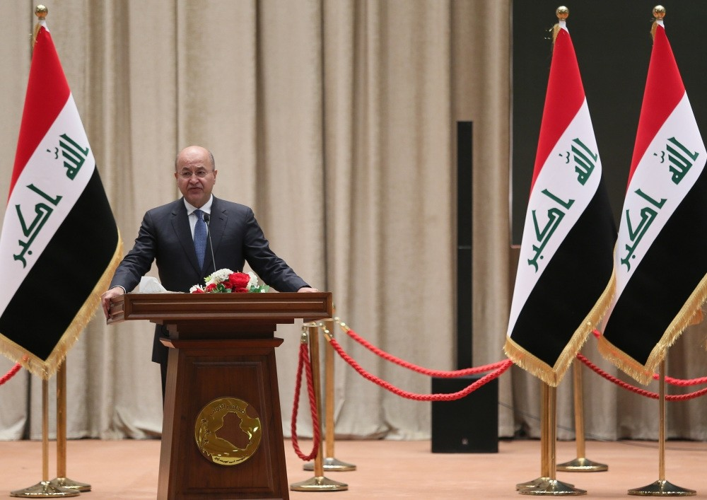 The newly elected Iraqi President Barham Salih delivers a speech at the parliament in Baghdad, Oct. 2.
