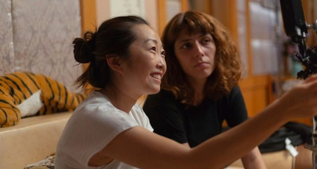 This image released by A24 shows director Lulu Wang, left, on the set of The Farewell. Women directed 12 of 2019's top 100-grossing films in 2019 Casi Moss/A24 via AP