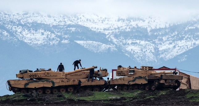 Turkish soldiers train with tanks and armored vehicles near the Turkish-Syrian border, Hatay, Jan. 24.
