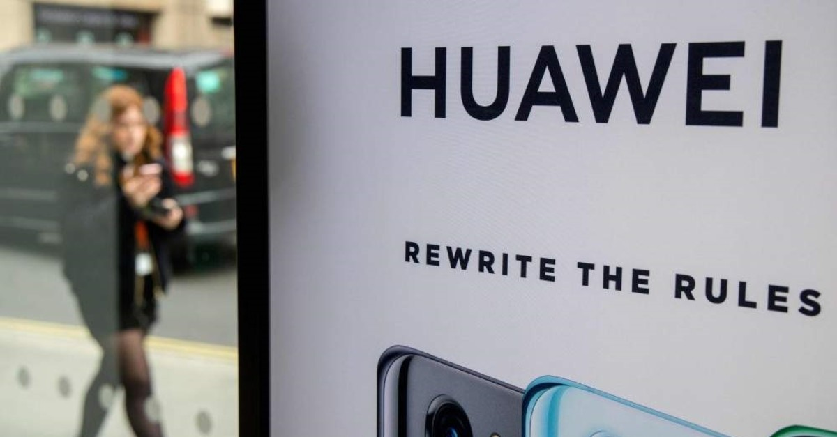 In this file photo taken on April 29, 2019, a pedestrian walks past a Huawei product stand at an EE telecommunications shop in central London. (AFP Photo)