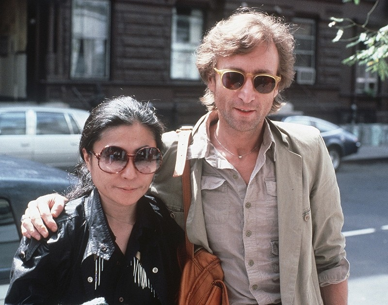 In this Aug. 22, 1980, file photo, John Lennon, right, and his wife, Yoko Ono, arrive at The Hit Factory, a recording studio in New York City. (AP Photo)