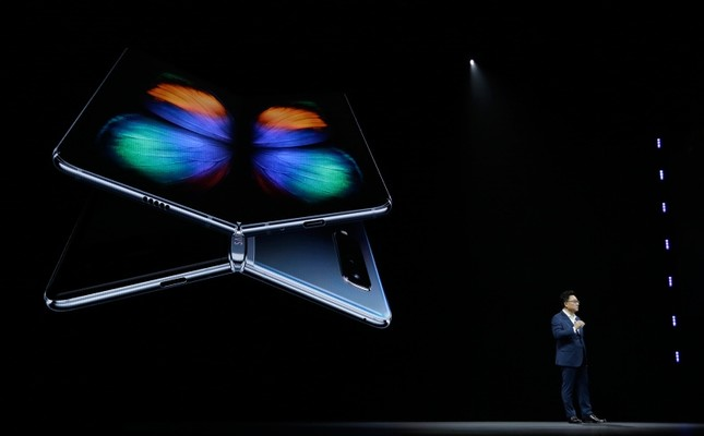 DJ Koh, Samsung President and CEO of IT and Mobile Communications, talks about the new Samsung Galaxy Fold smartphone during an event Wednesday, Feb. 20, 2019, in San Francisco. (AP Photo)