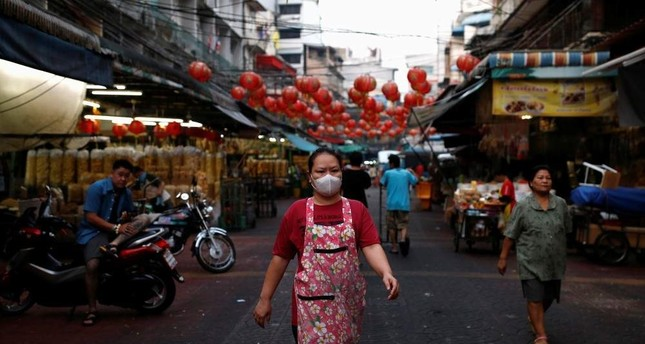 A woman wears a mask to prevent the spread of the new coronavirus as she walks in Chinatown at Bangkok, Thailand February 2, 2020. Reuters Photo