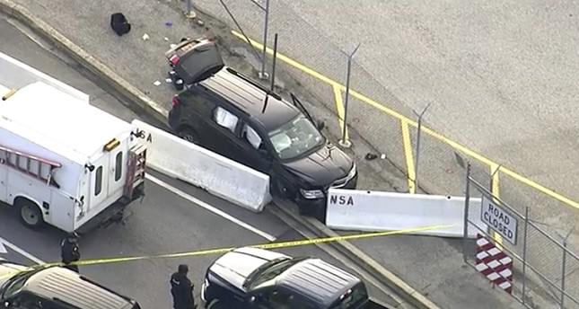 In this image made from video and provided by WUSA TV-9, authorities investigate the scene of a shooting at Fort Meade, Md. on Feb. 14, 2018. (AP Photo)