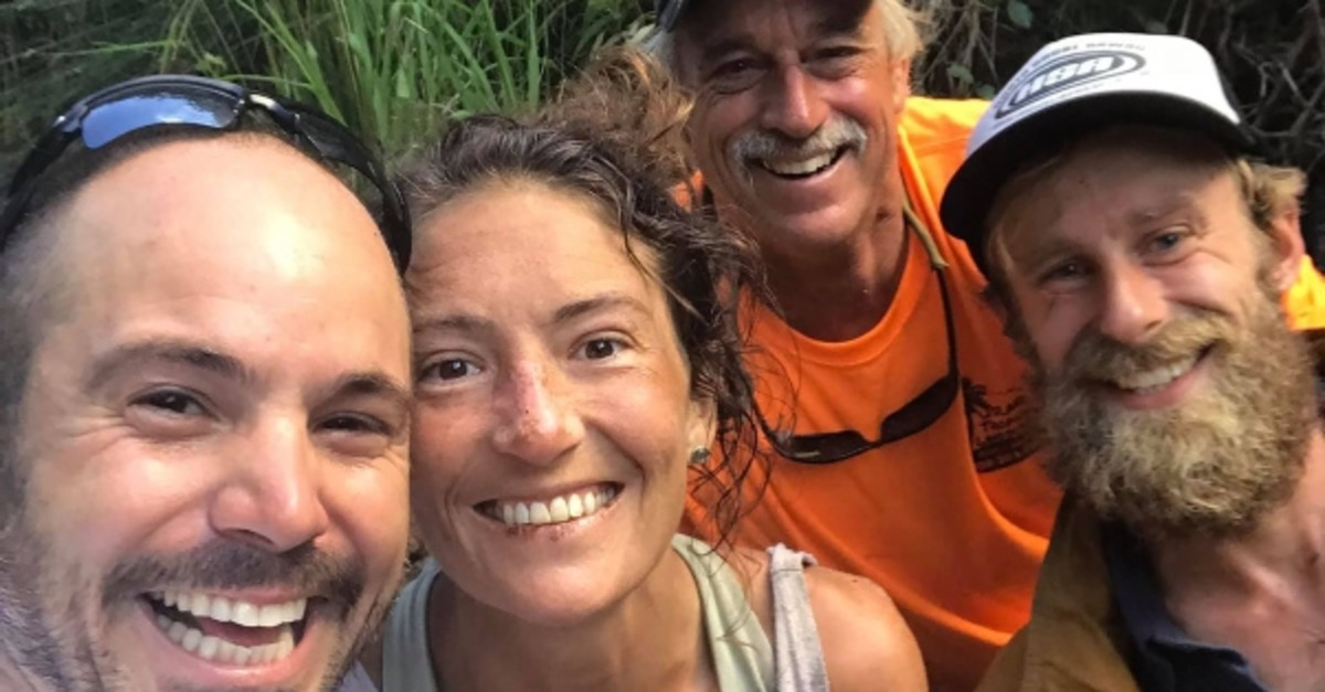 In this image courtesy of Javier Cantellops and obtained at facebook.com/AmandaEllersMissing/, shows missing hiker Amanda Eller with her rescuers, (L-R) Cantellops, Troy Helmer and Chris Berquist, on May 24, 2019 on the island of Maui. (AFP Photo)