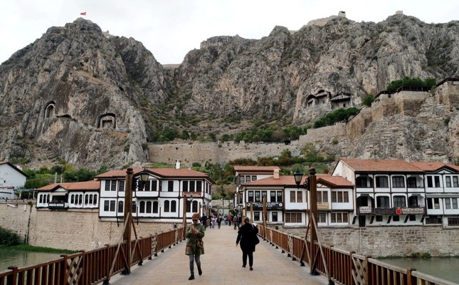 The rock-cut tombs of Pontus kings overlooks historical houses dating back to the Ottoman era.