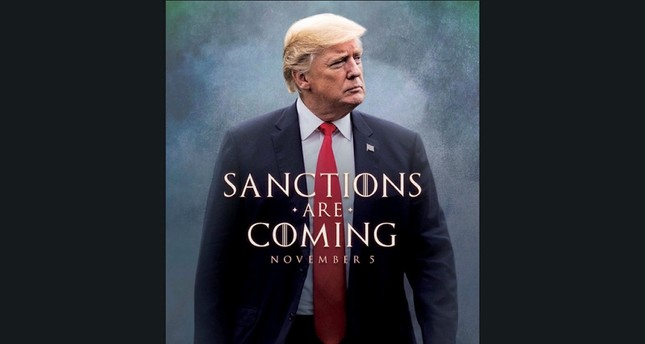 """Trump tweeted a photo of himself with the words """"Sanctions are Coming"""" Nov. 5. (Twitter photo via AP)"""