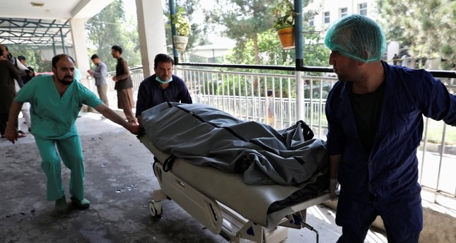 Emergency workers transport the dead body of a victim to the hospital after a blast in Kabul, Afghanistan July 25, 2019 (AFP Photo)