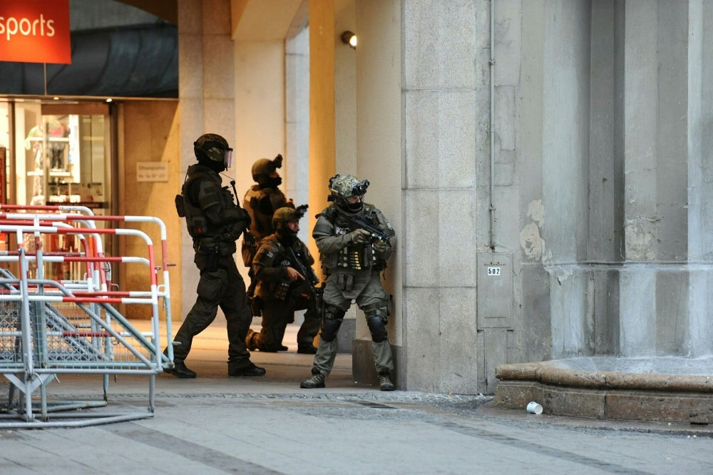 Heavily armed police forces operate at Karlsplatz square after a shooting in the Olympia shopping center was reported in Munich, southern Germany, July 22, 2016.